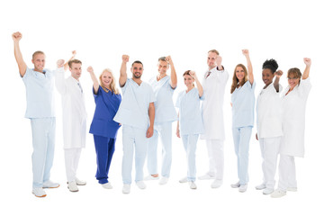 Multiethnic Medical Team Standing With Arms Raised