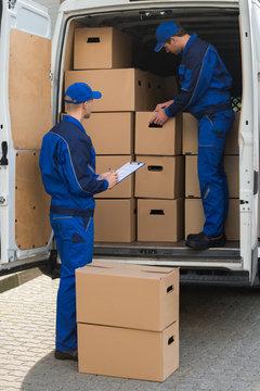 Delivery Men Unloading Boxes