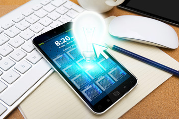 Modern mobile phone with lightbulb