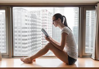 Education concept - woman using laptop