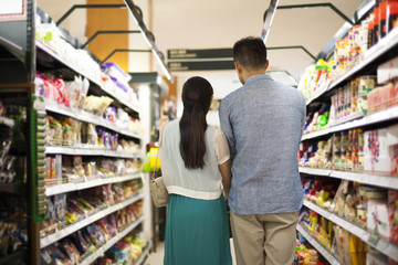 Rear view of couple shopping in a supermarket