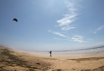 flying a kite on beach in Brittany, France