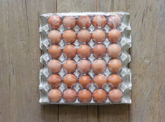 Eggs in paper tray with cover