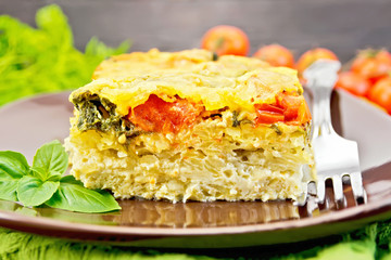 Pie potato with tomato and cheese on board