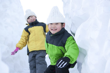 Cute children having fun in snow