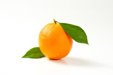 Whole orange with leaves