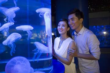 Young couple in aquarium
