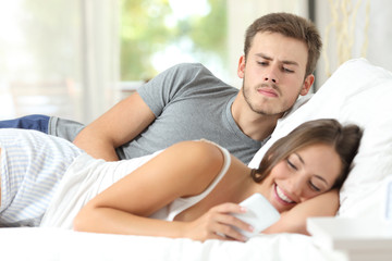 Jealous gossip man watching his wife mobile phone