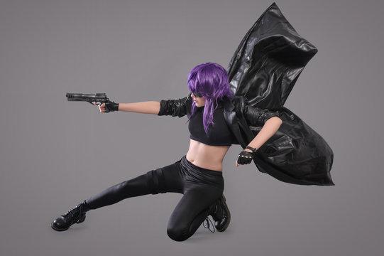 Woman with gun / Portrait of sexy woman posing in studio with gun