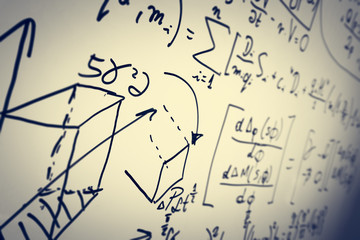 Complex math formulas on whiteboard. Mathematics and science with economics