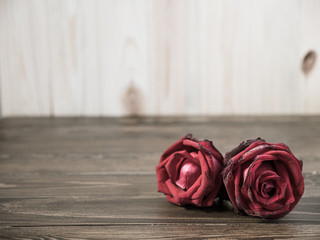 Vintage photo of roses flowers on wooden backgrounds.
