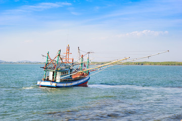 Small fishing boats near the island of Chanthaburi , Thailand