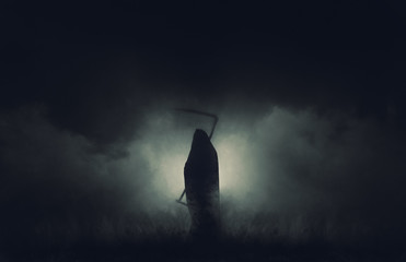 Grim reaper, the death itself, scary horror shot of Grim Reaper in fog holding scythe. Wall mural