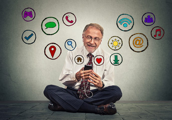 man sitting on floor using texting on smartphone browsing web social media applications