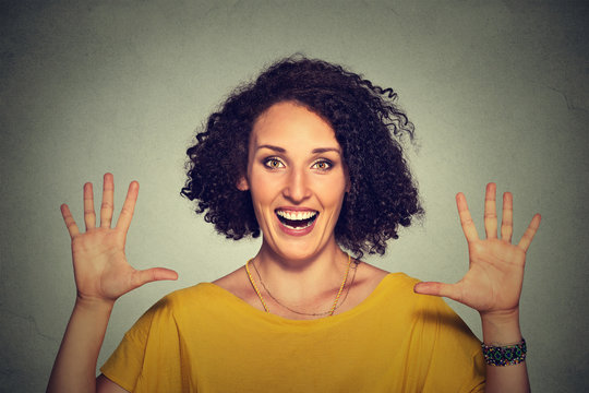 happy, smiling young woman making five times sign gesture with hands fingers