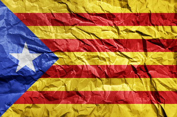 Catalonia flag painted on crumpled paper background