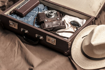 Traveler's suitcase with vintage items