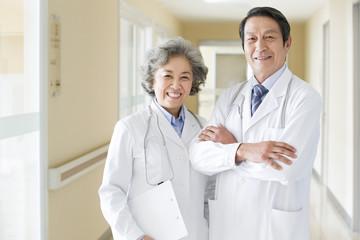 Portrait of senior doctors standing in hospital