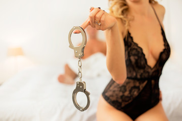 Seductive woman holding handcuffs