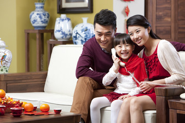 Young family on the phone during Chinese New Year