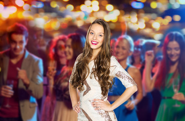 happy young woman or teen girl at disco club