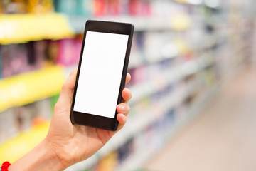 Person holding smartphone in supermarket