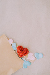 Valentines day background with red hearts over texture paper bac