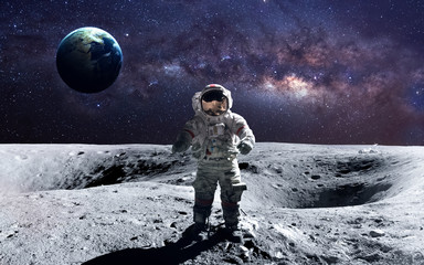 Wall Mural - Brave astronaut at the spacewalk on the moon. This image elements furnished by NASA.
