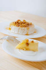 Camembert cheese with honey sauce with nuts and butter