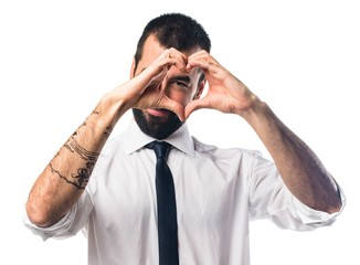 Businessman making a heart with his hands