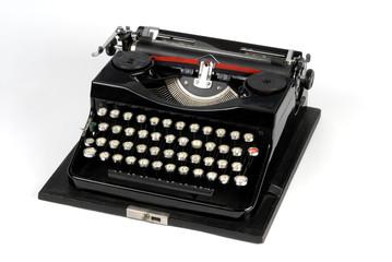 Old typewriter machine isolated on white