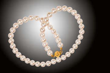 Pearl necklace isolated on black