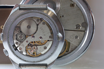 Watch machinery macro detail. Time within. Old watch with no caps. Clockwork.