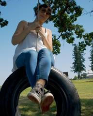 Women on a tire swing