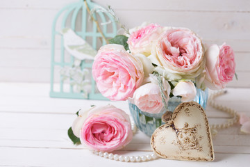 Background with  pink roses flowers  in blue vase and decorative