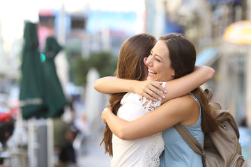 Fototapeta Happy meeting of friends hugging obraz