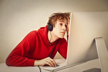 Boy listening music at the computer