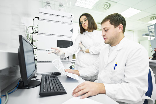 Researchers analyzing liquid chromatography data