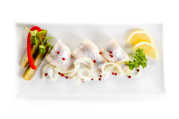Marinated herring fillets on white background