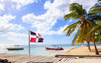 Caribbean beach and Dominican Republic flag