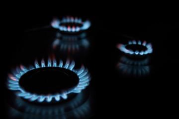 Three blue gas flames