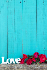 Love and red roses border blank blue wood background