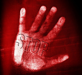 Stop - keine Gewalt - no violence - Textured hand with word STOP