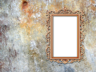 Close-up of one baroque metal picture frame on weathered wall background