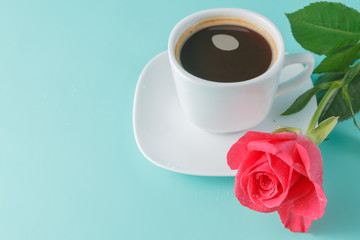 cup of coffee on the table with rose flower