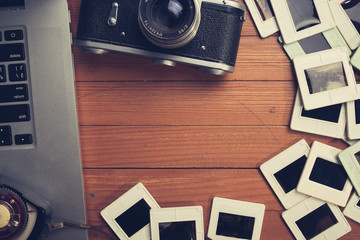 composition of old photo camera, laptop and photo slides
