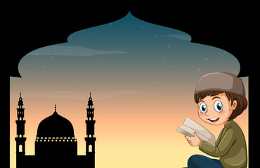 Muslim boy reading book with mosque background