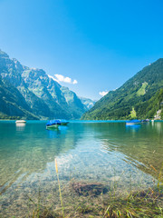 Stunning view of Kloentaler lake in Summer