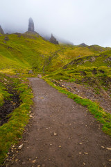 Wall Mural - Tourist track to the Old Man of Storr on a cloudy day - Isle of Skye, Scotland, UK