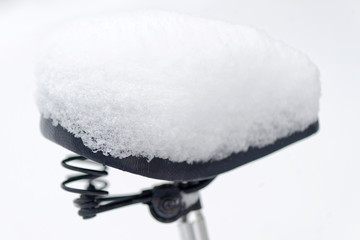 Bike saddle covered in snow